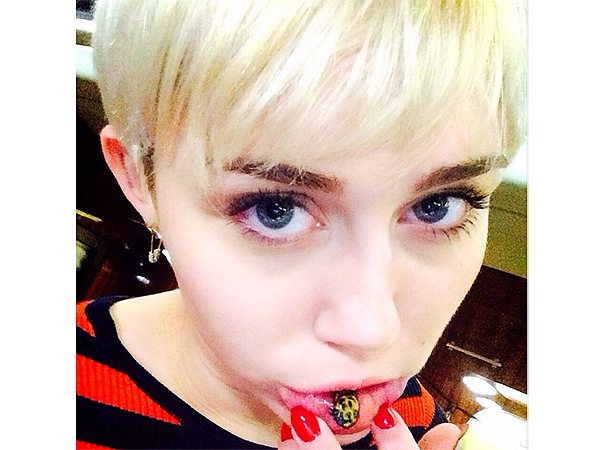 Miley Cyrus Shows Off New Lip Tattoo People Com