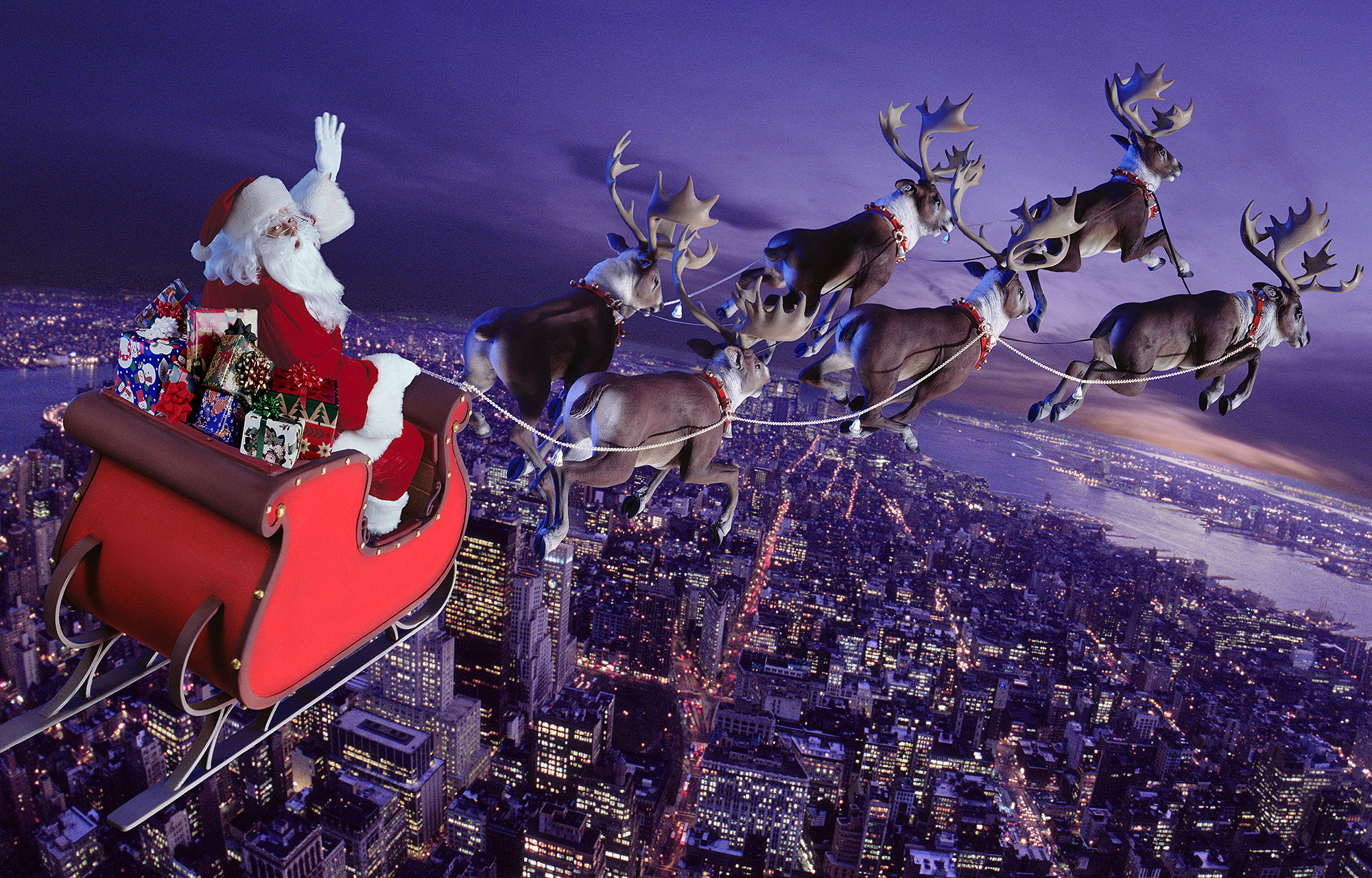 santa claus riding sleigh holding rope of reindeer rudolph teams background