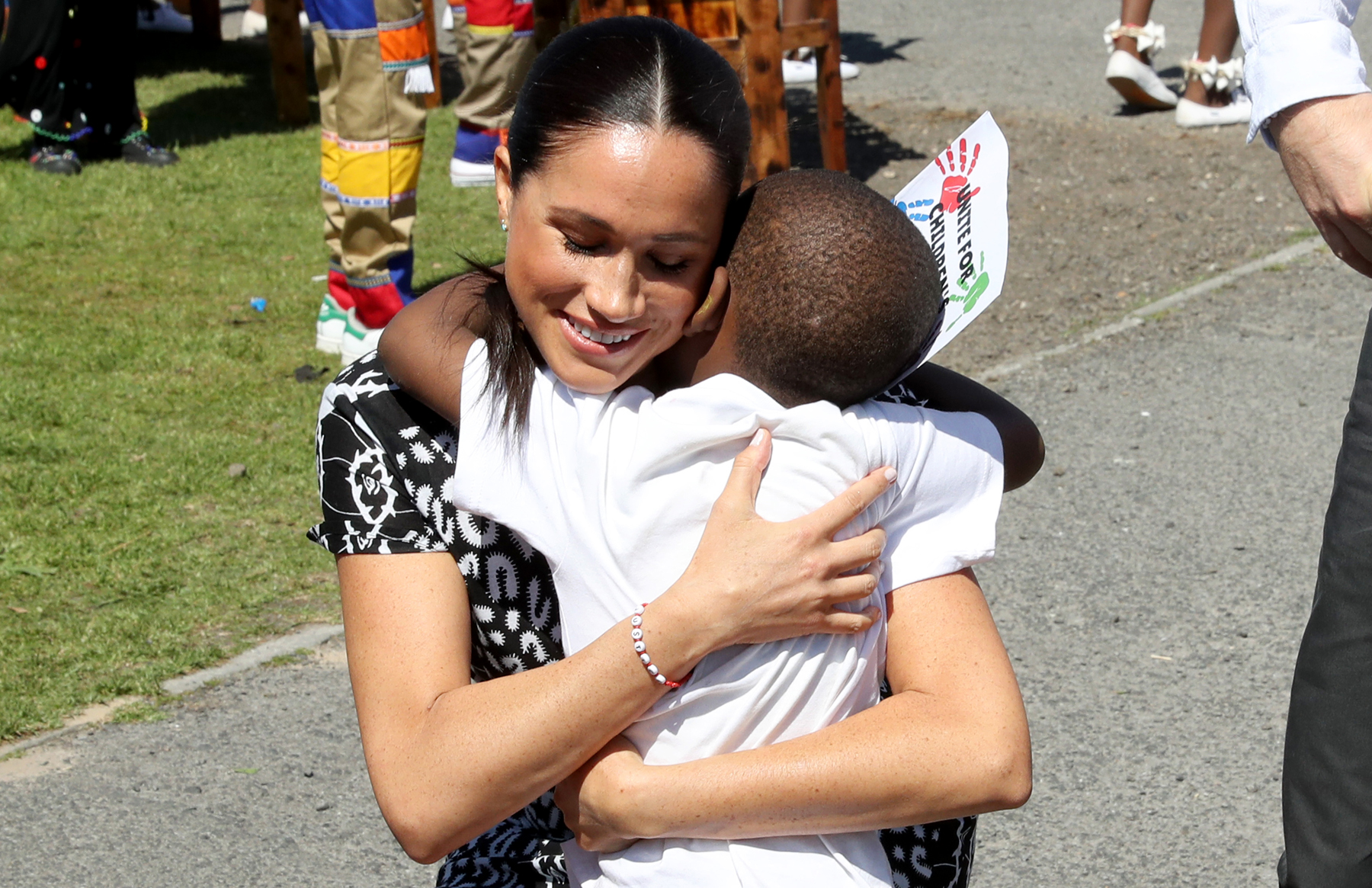 meghan markle prince harry playing with kids on south africa tour people com https people com royals cutest photos of meghan markle and prince harry playing with kids including archie on royal tour