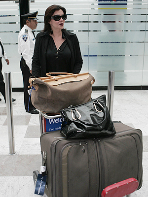 SHE'S GOT BAGGAGE