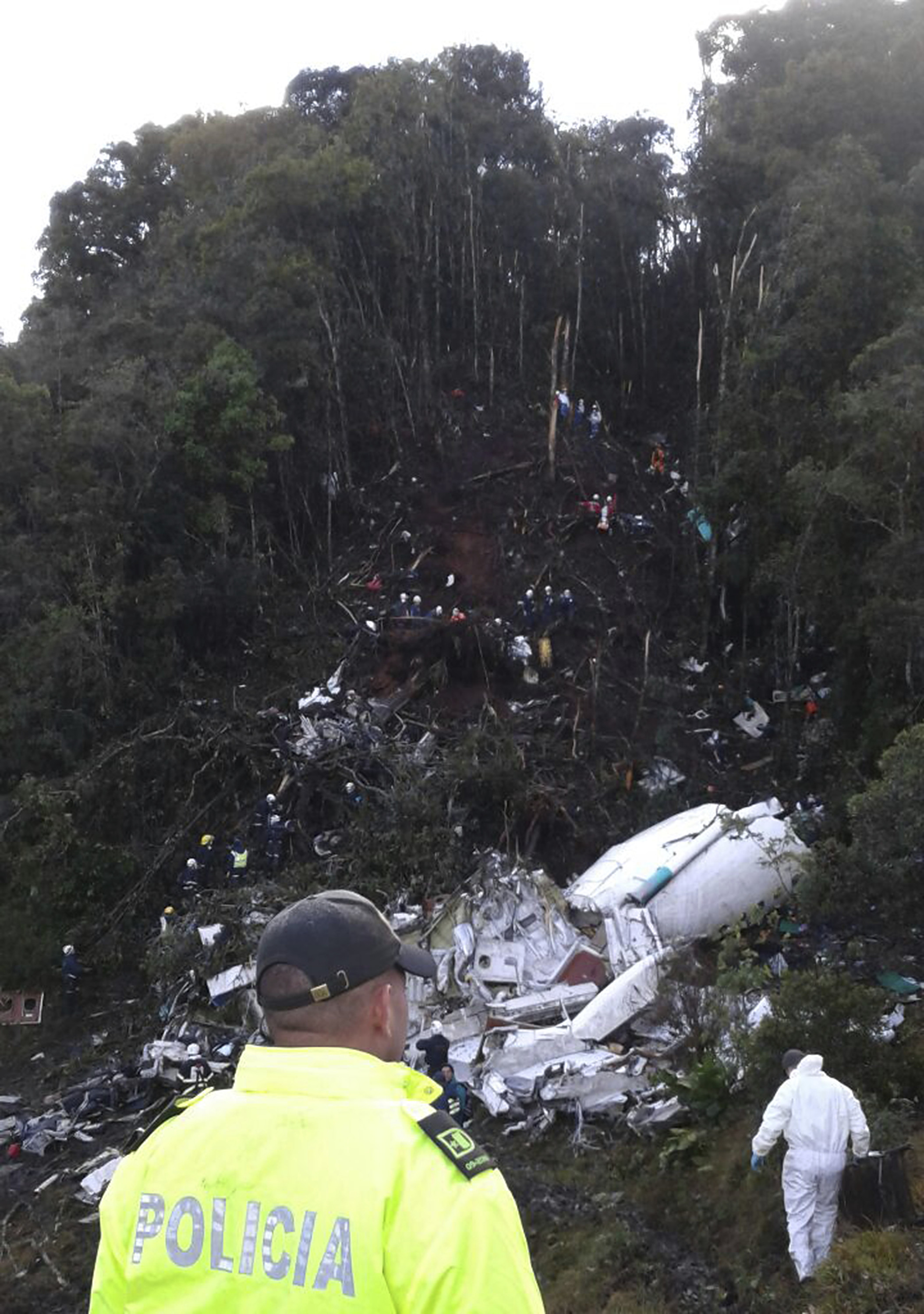 LA UNION, COLOMBIA - NOVEMBER 29: In this handout picture by Defensa Civil Antioquia Police officers work on the wreckage of the Lamia plane wich transported Brazilian football team Chapecoense at El Gordo Mount on November 29, 2016 in La Union, Colombia. On the crash 76 people were killed and 6 survived. (Photo by Defensa Civil Antioquia/LatinContent/Getty Images)