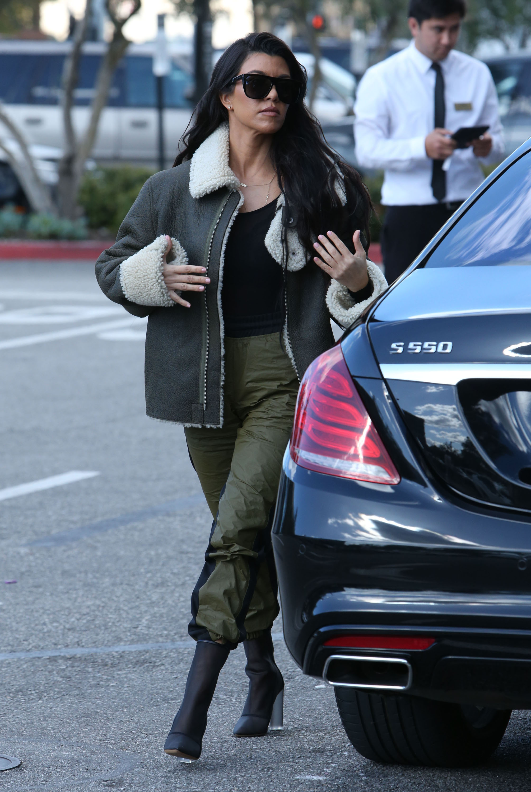 Kim Kardashian Pairs Sexy Lace Top With Loose-Fit Sweats