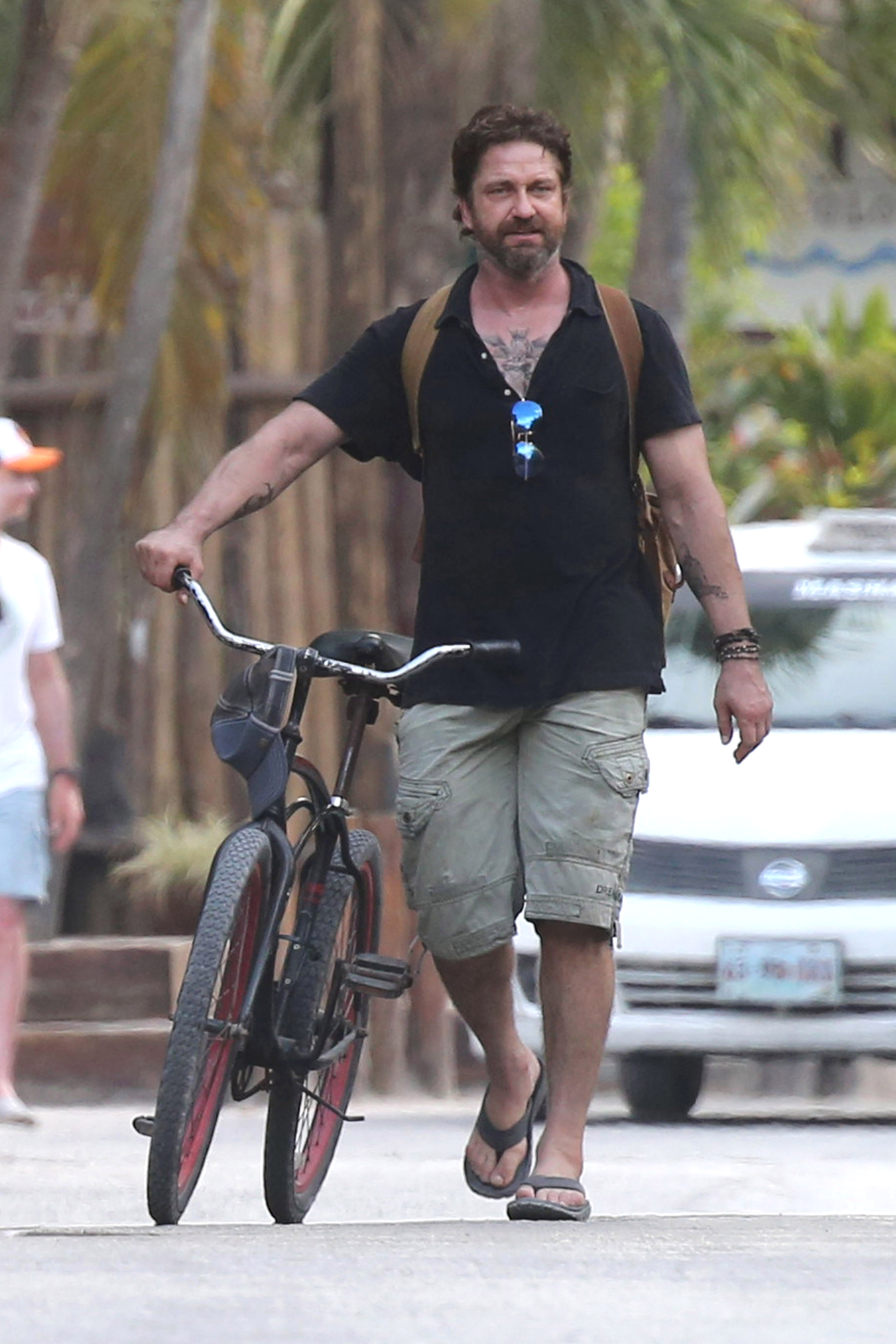 EXCLUSIVE Gerard Butler Reveals New Chest Tattoo With On-Again Flame Morgan Brown In Cancun