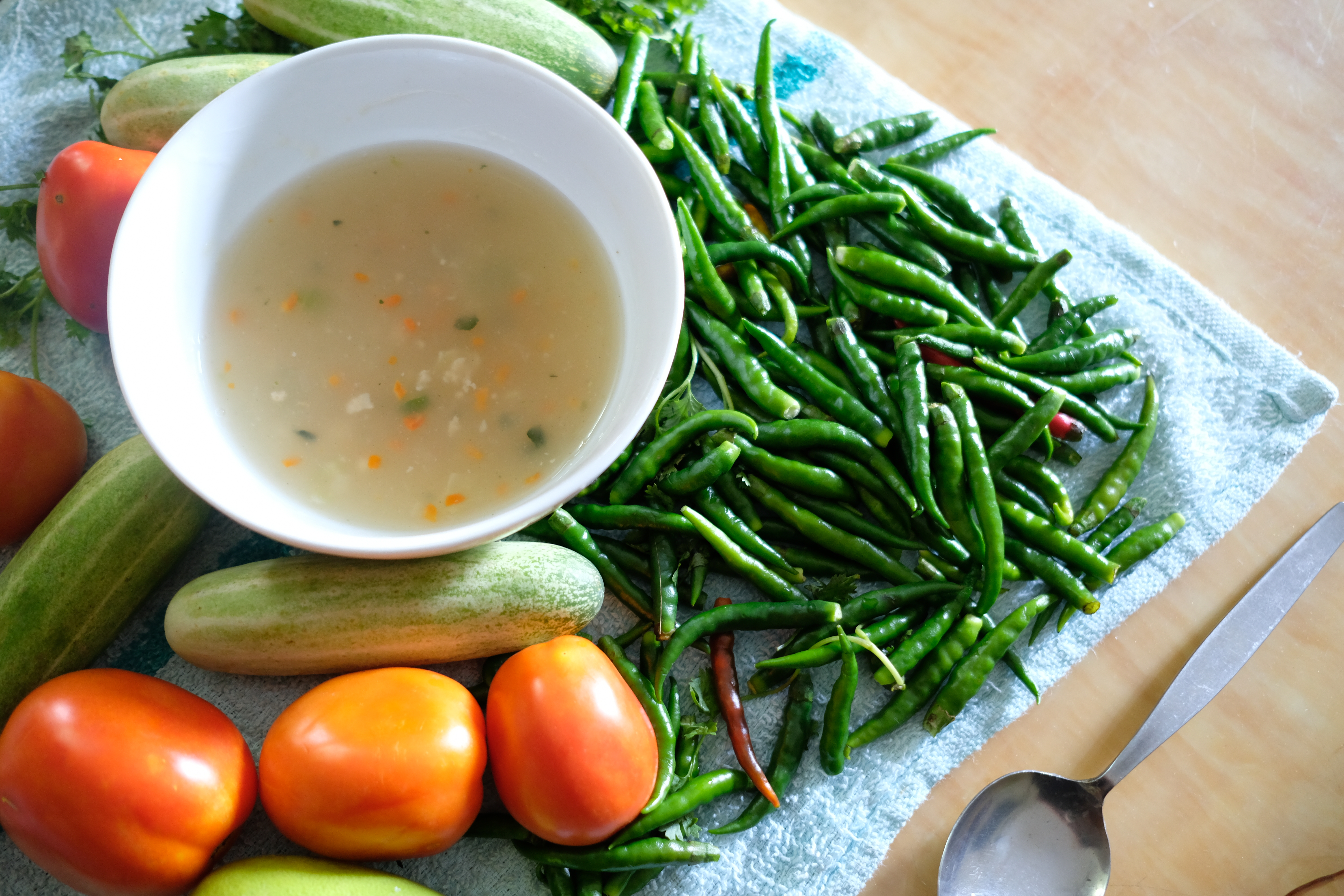 fresh fruits and vegetables with soup on table