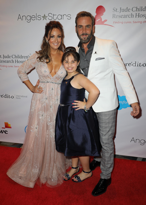 Karla Monroig and Carlos Ponce