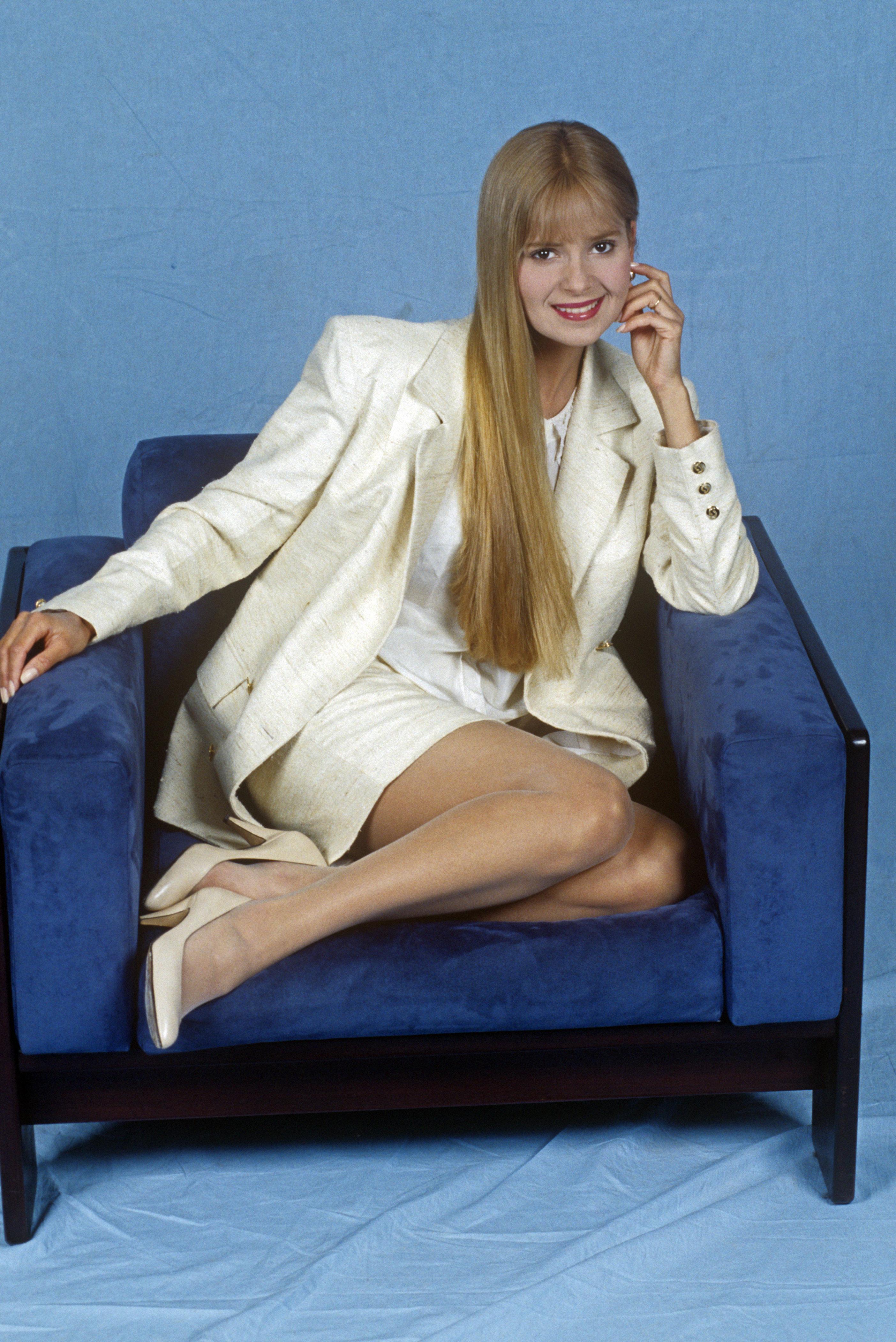 Grecia Colmenares sitting on an armchair