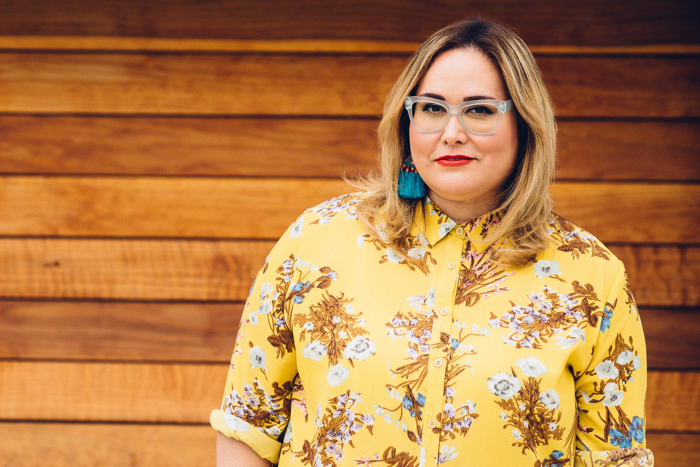 tanya-saracho-headshot-yellow-shirt-glasses1.jpg