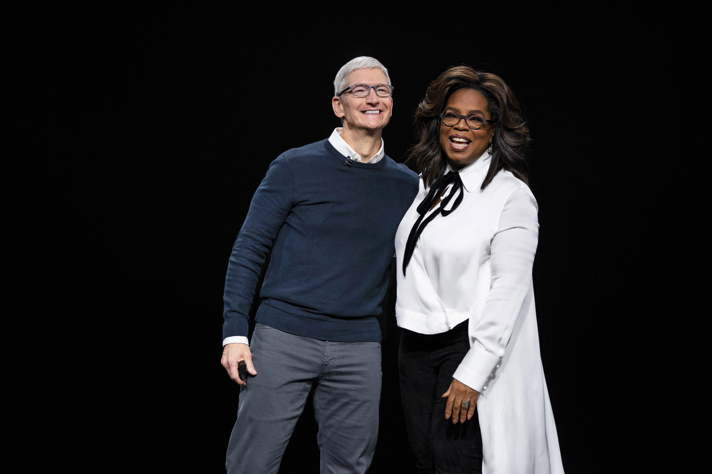 Tim Cook and Oprah Winfrey