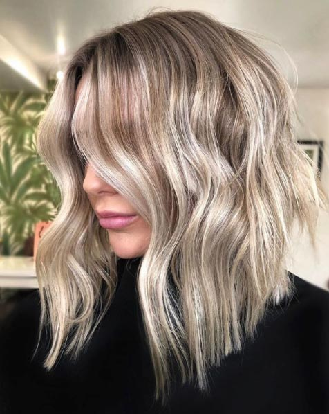 25 Medium Blonde Hairstyles To Show Your Stylist Pronto Southern Living