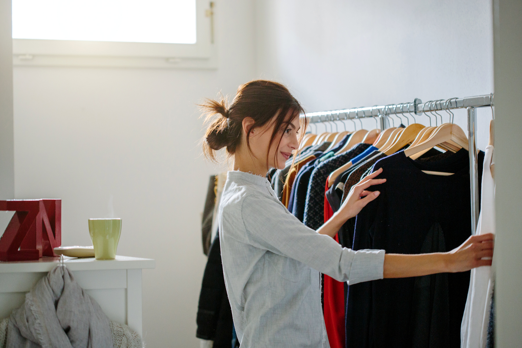 woman looking at clothes