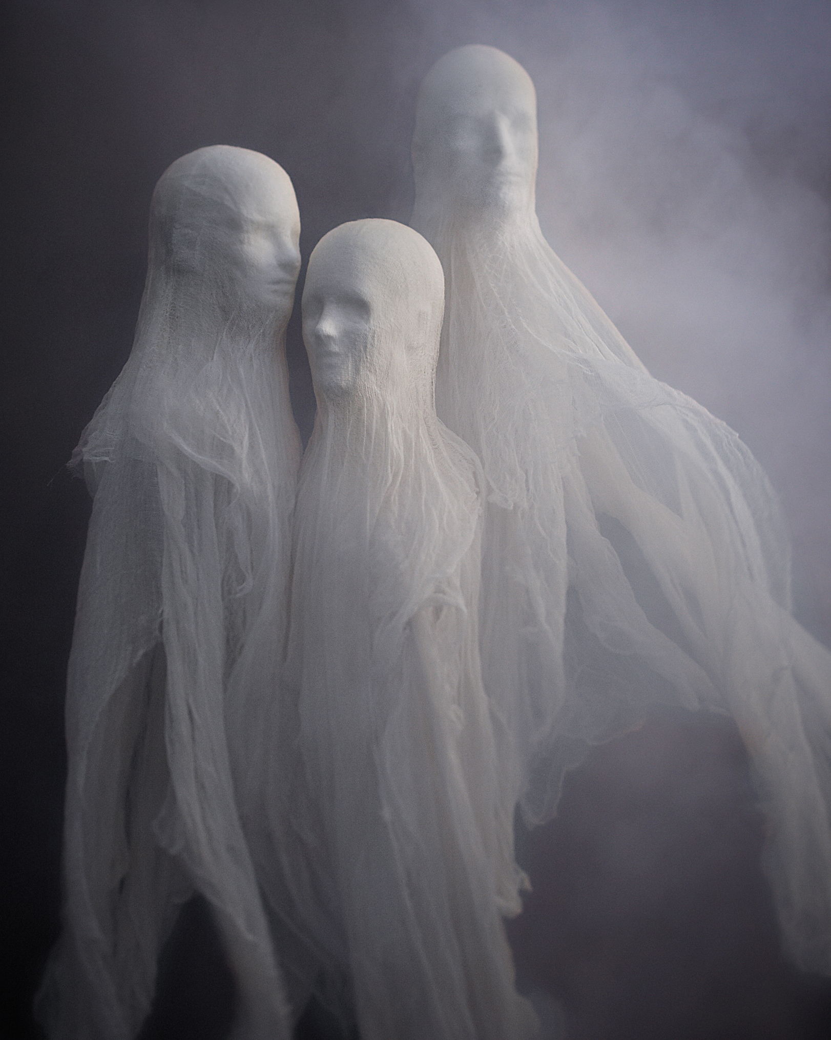 Inviting these spooky floating guests inside will keep other ghouls on their toes. Making these foreboding decorations is actually very easy—styrofoam mannequin heads are sold at wig shops, and while they can stand on their necks, suspending them lets the cloth flow freely.