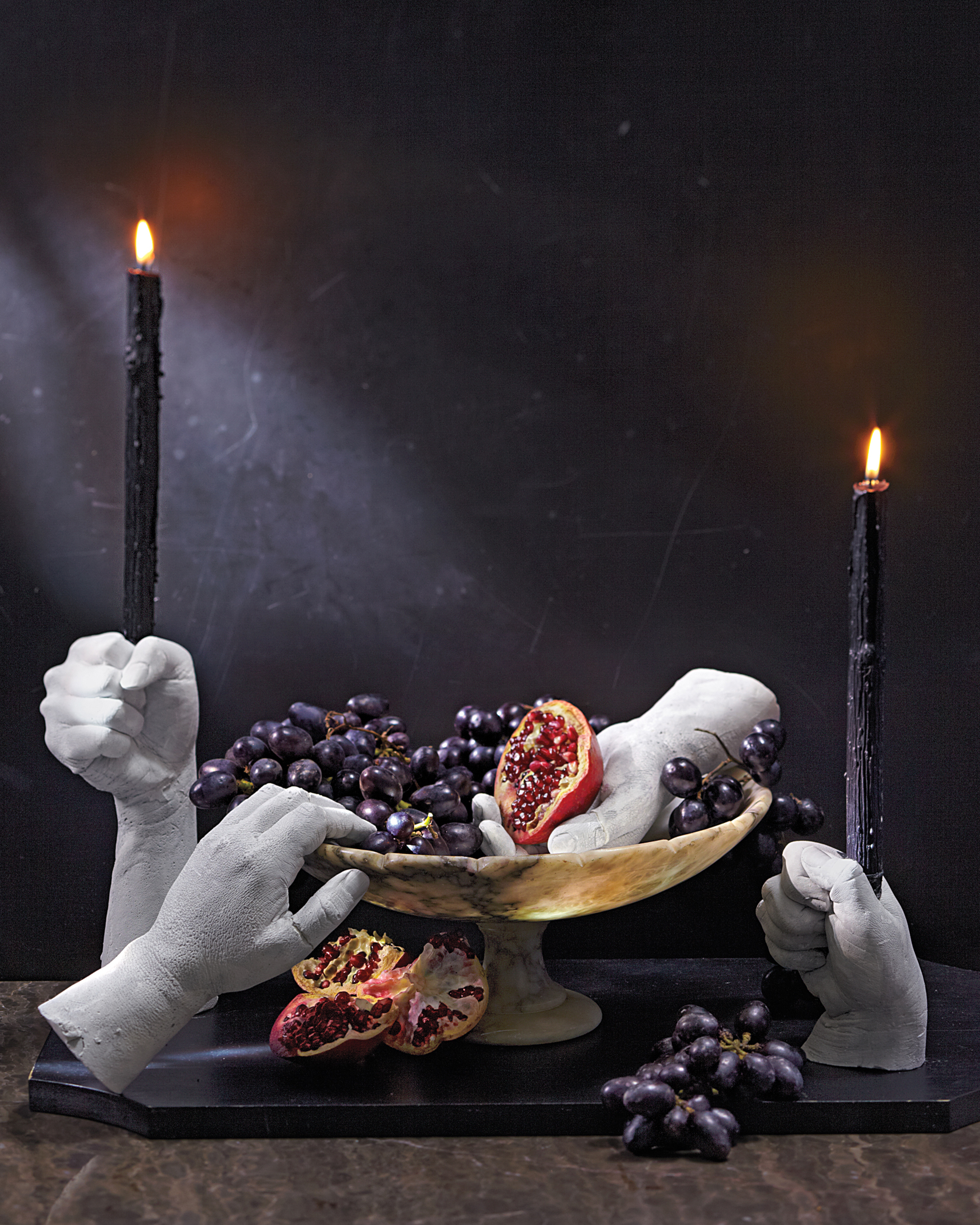 On Halloween, consider taking your fearin hand and making five-fingered candleholders and tabletop decorations.