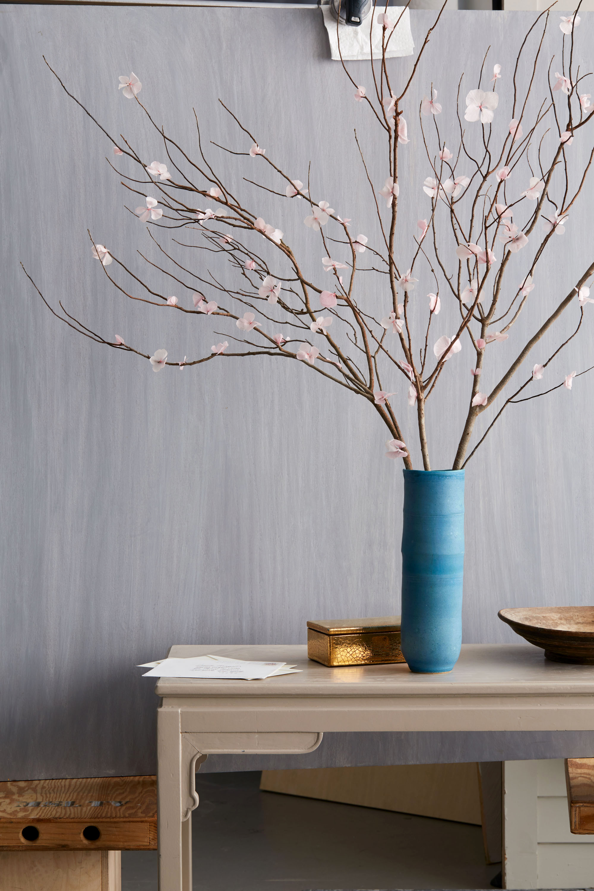 dried flower branches in a blue vase