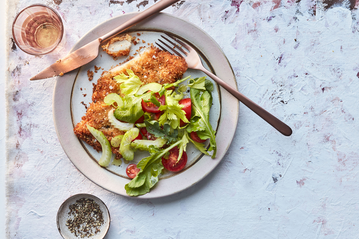 thyme-and-sesame-crusted cutlets with copper cutlery
