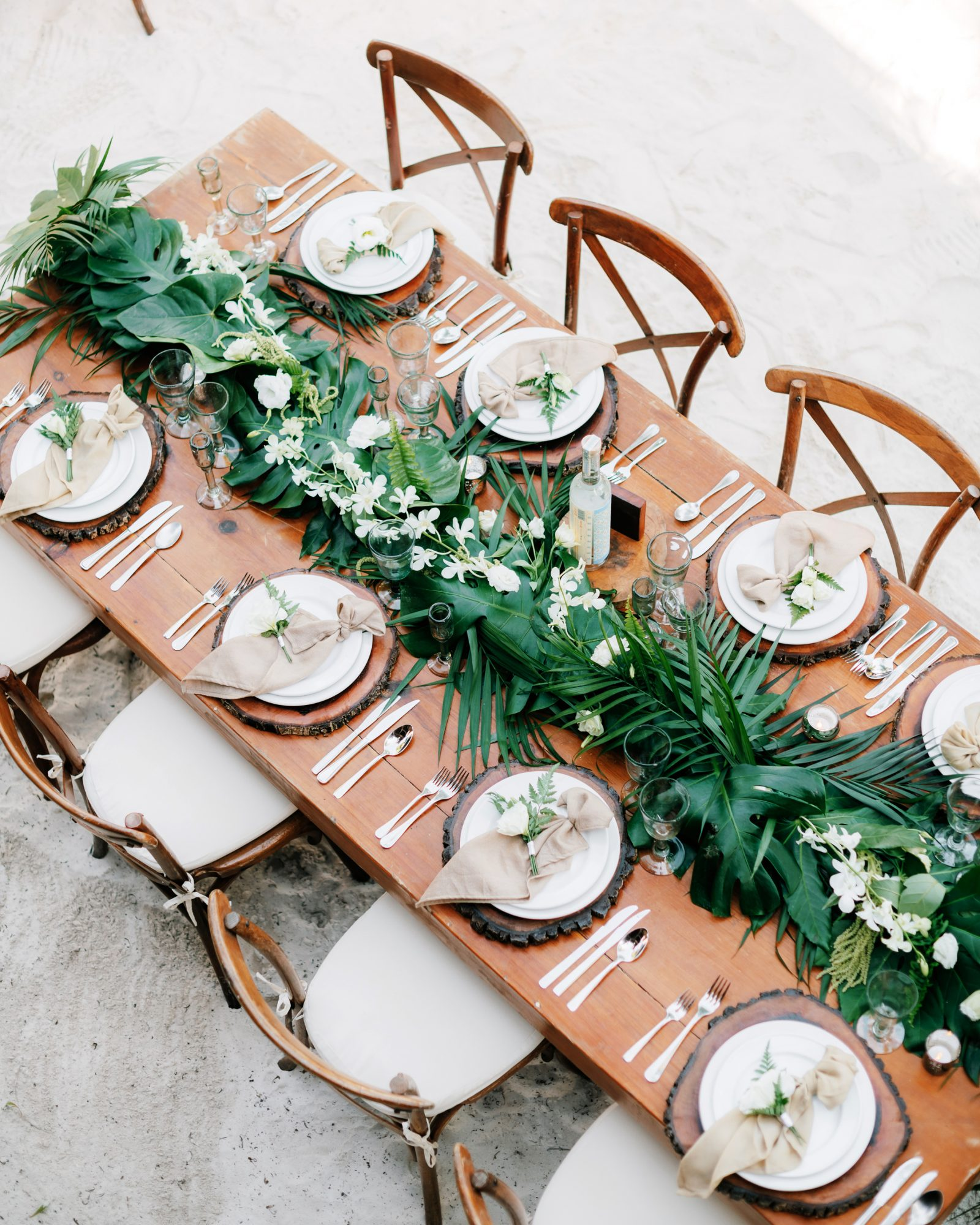 Tropical Wedding Ideas That Will Transform Your Big Day Into An Oasis Martha Stewart Palm leaf wedding décor also works in many situations thanks to the leafy green hue, a neutral in the flower world. tropical wedding ideas that will