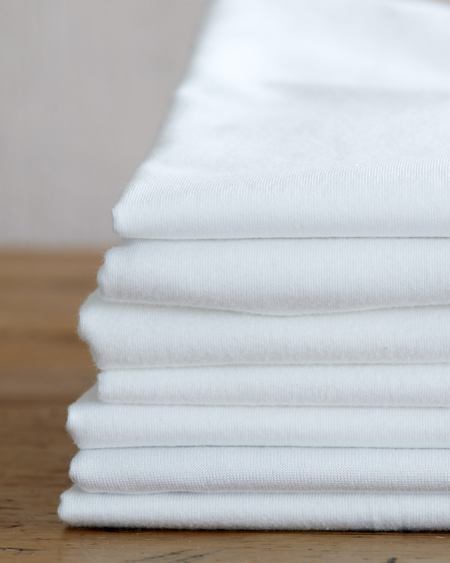 How to Wash White Clothes and Keep Them Looking as Bright as They Did on Day One