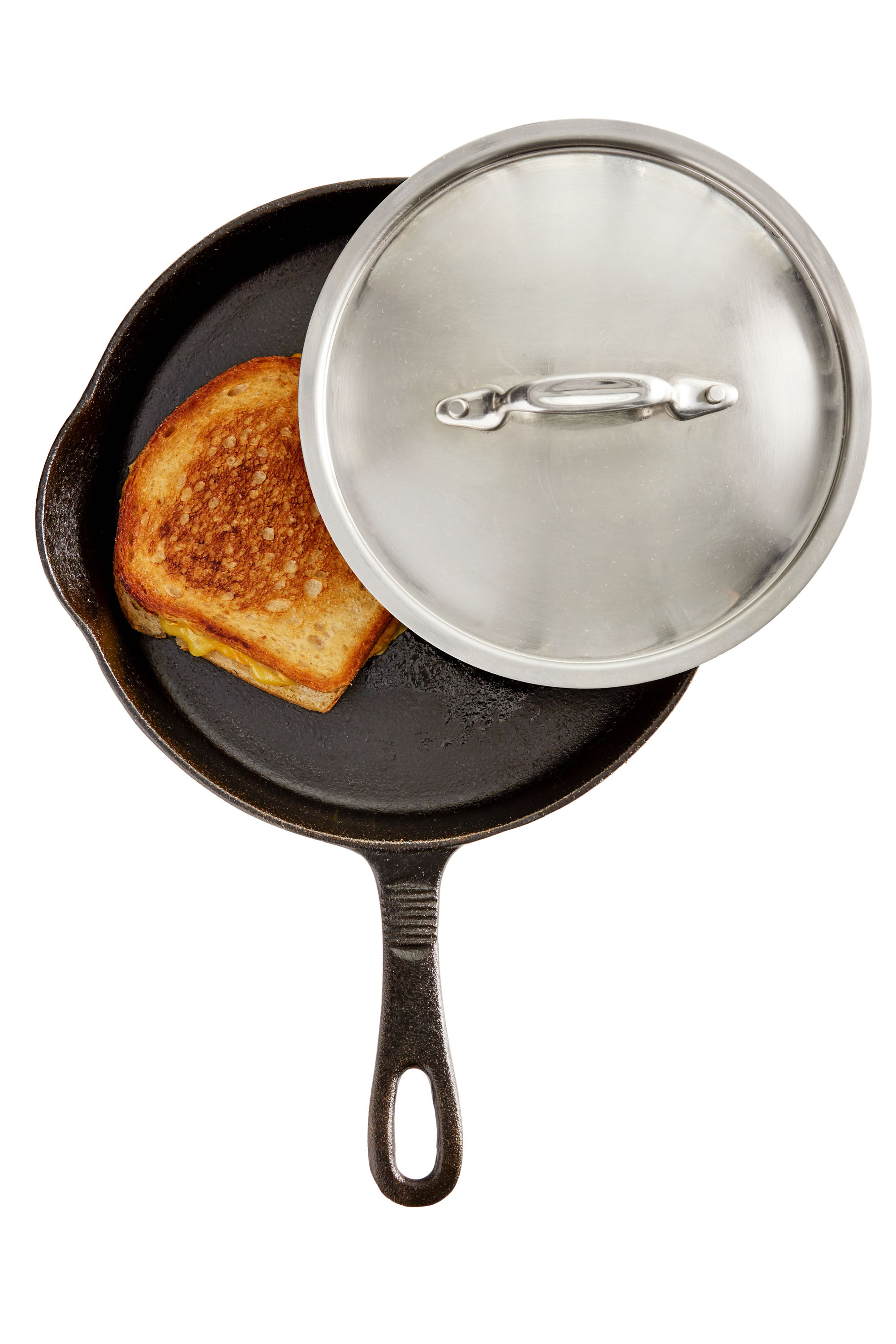 grilled cheese in pan with lid