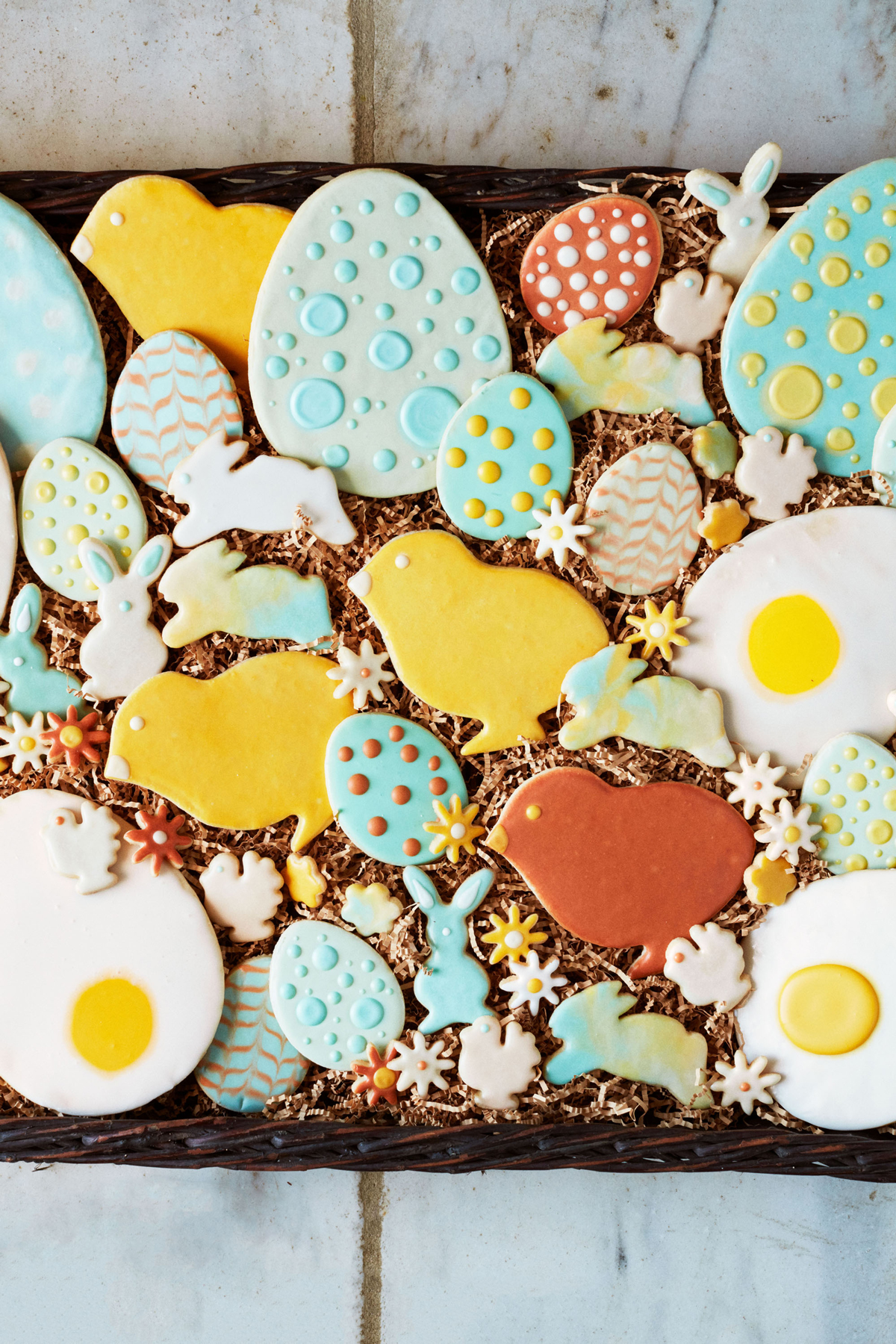 colorful frosted spring themed and easter egg sugar cookies
