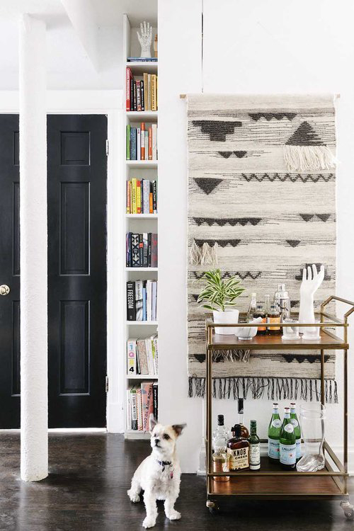 textile wall art entryway with dog