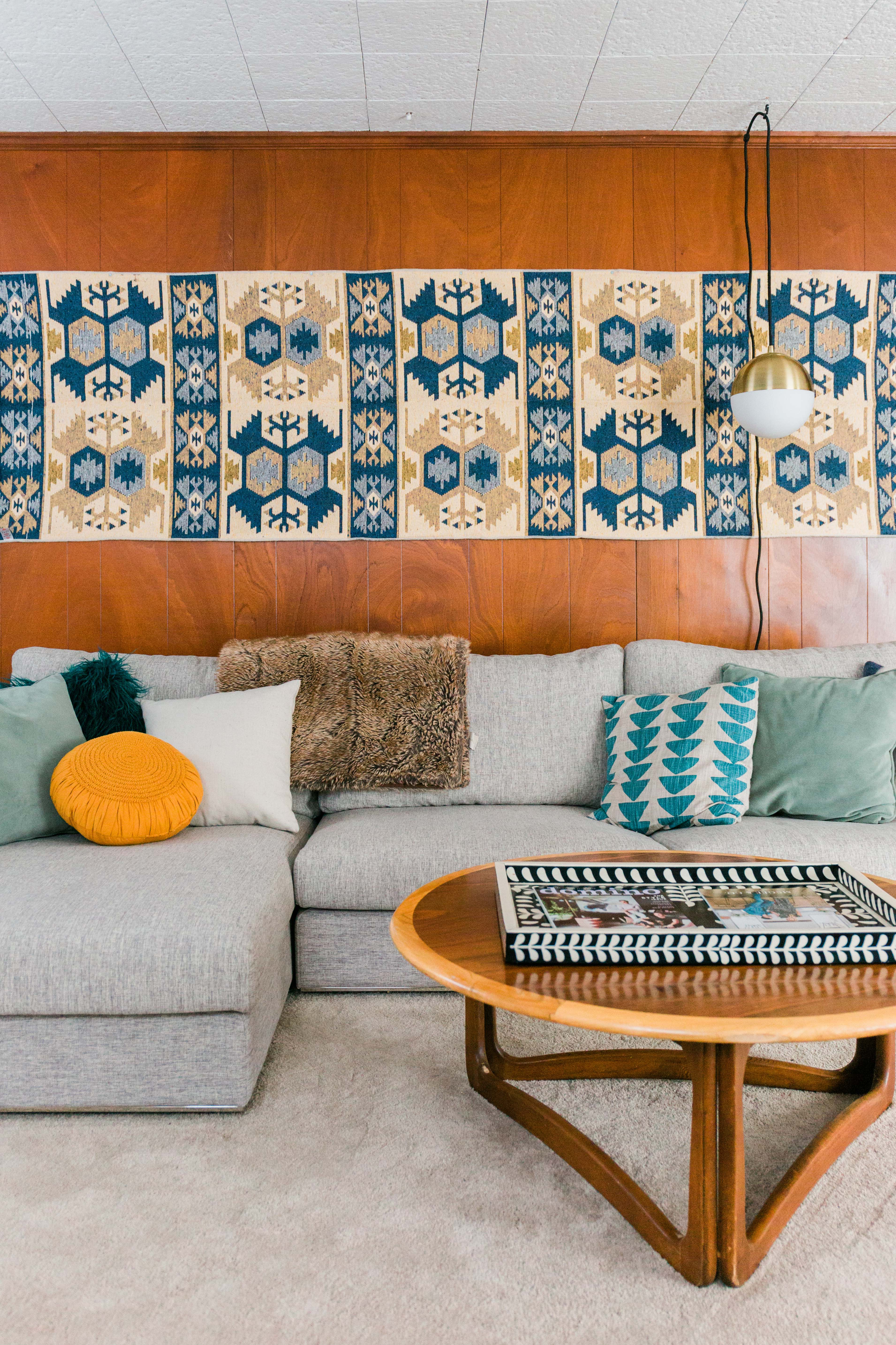 textile wall art above living room couch