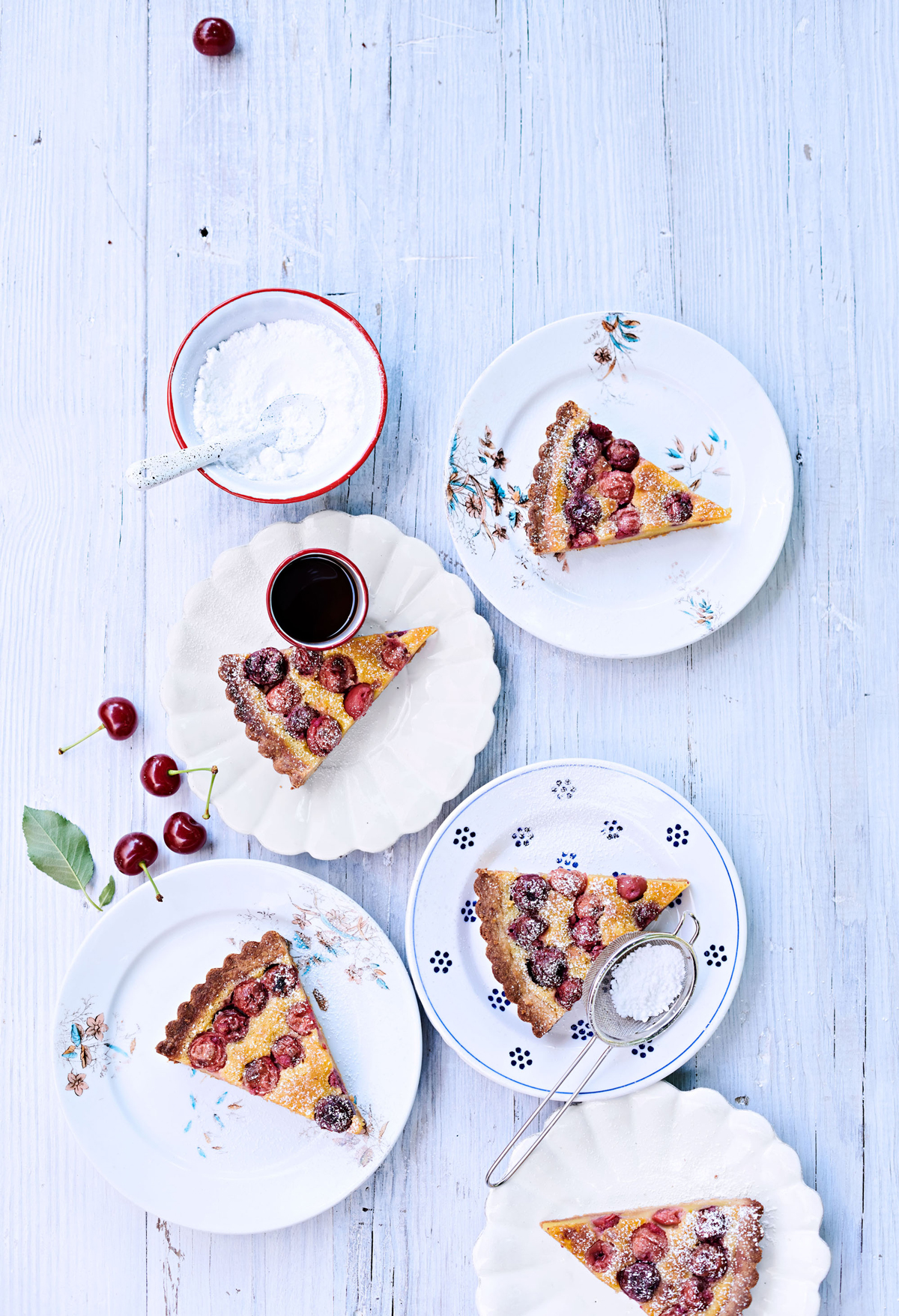sour-cherry frangipane tart topped with powdered sugar