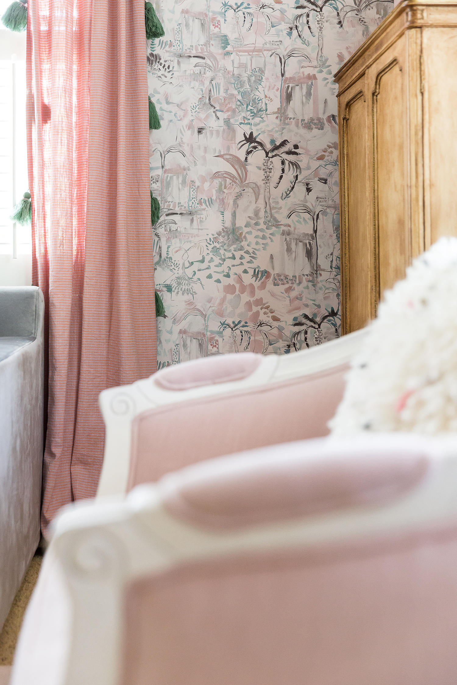 pink and gray-blue wallpaper and curtain