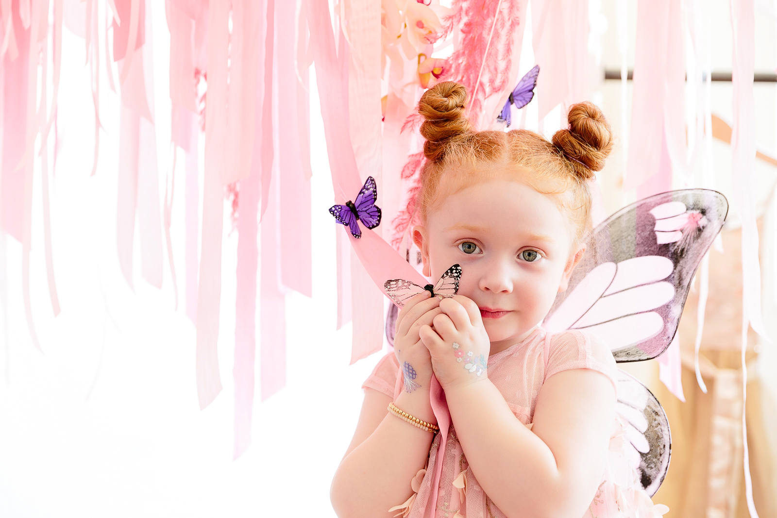 butterfly party little girl holding butterfly