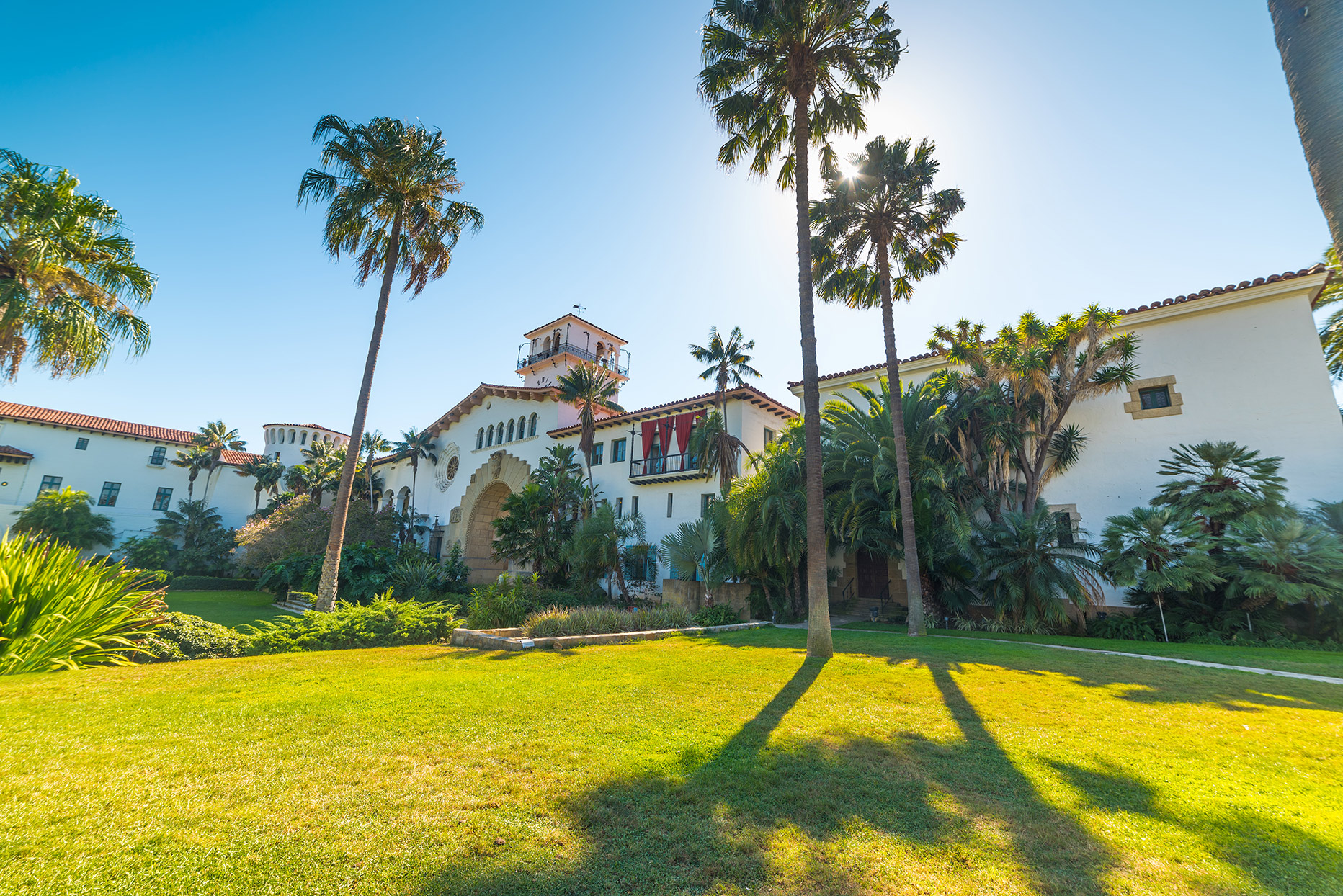spanish colonial style home palm trees