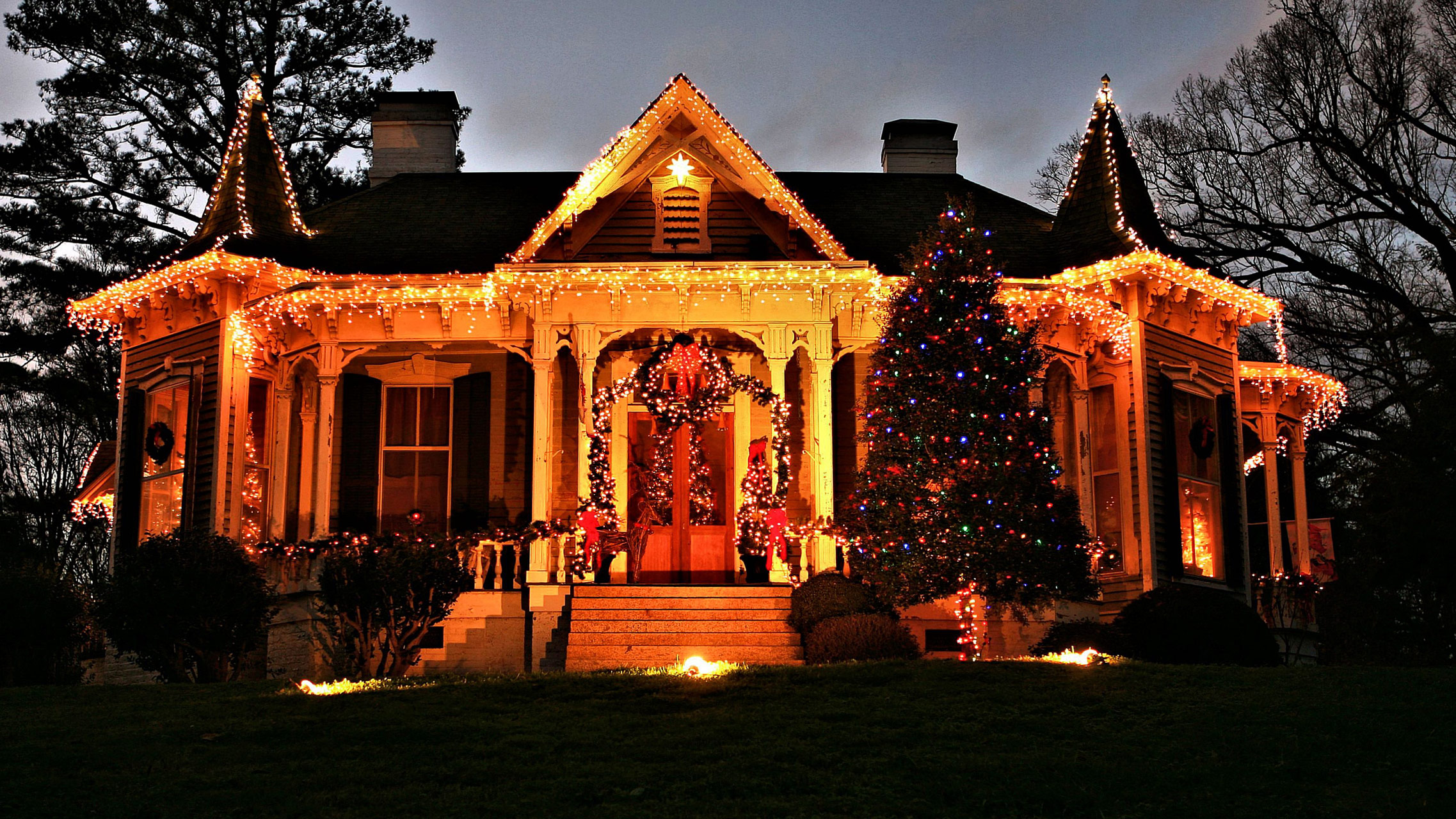home decorated in Christmas lights night shot