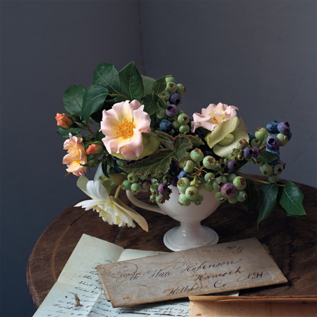 blueberries and roses floral arrangment