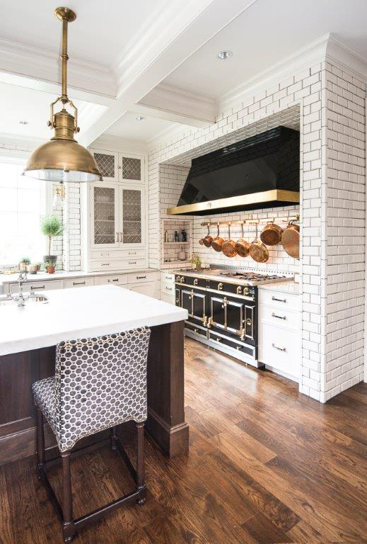 dual range oven in white black and golden kitchen