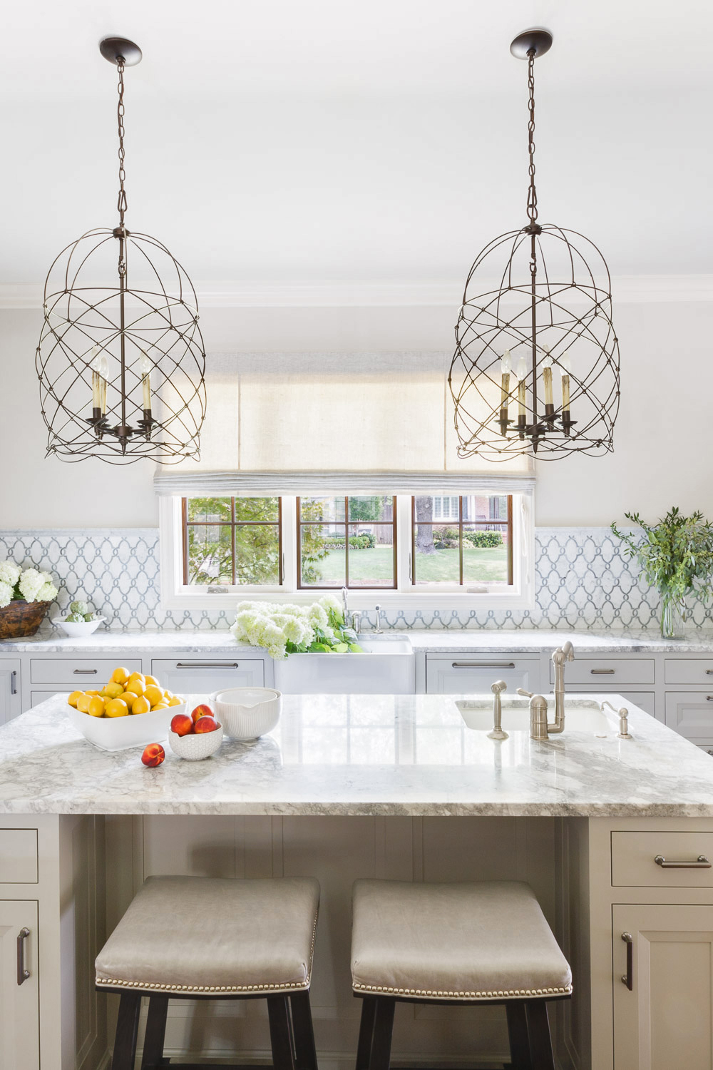 silver and white tile backsplash in bright kitchen