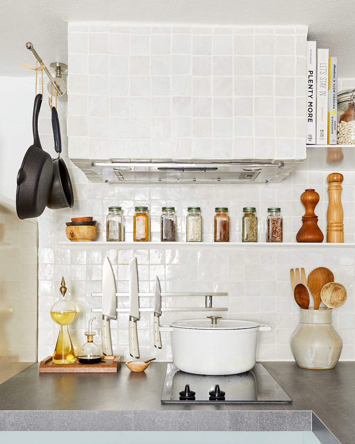 white square tile backsplash with spice rack