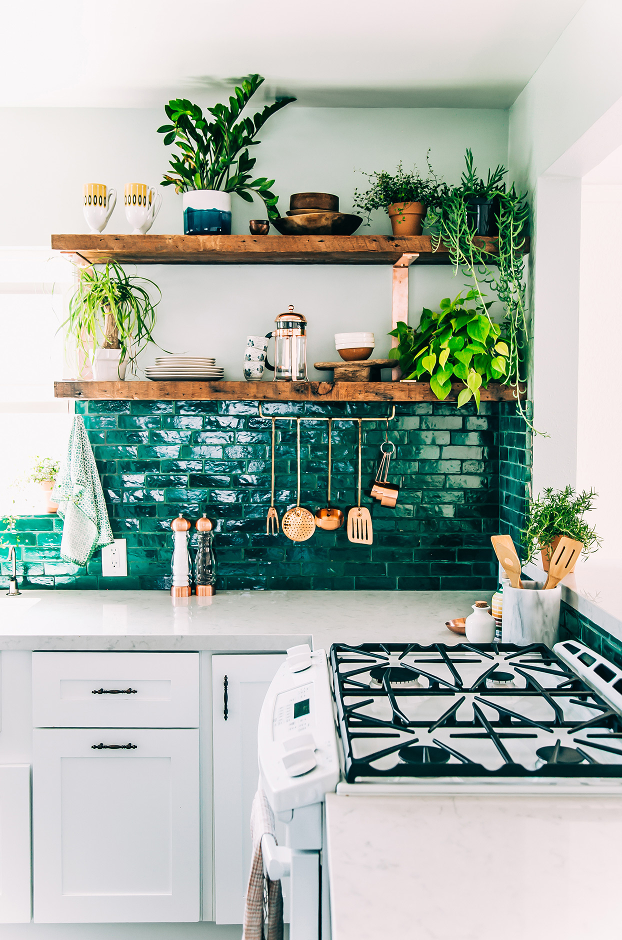 bold teal tile and grout backsplash