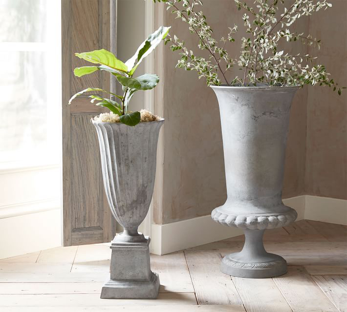 large stone vases with plants