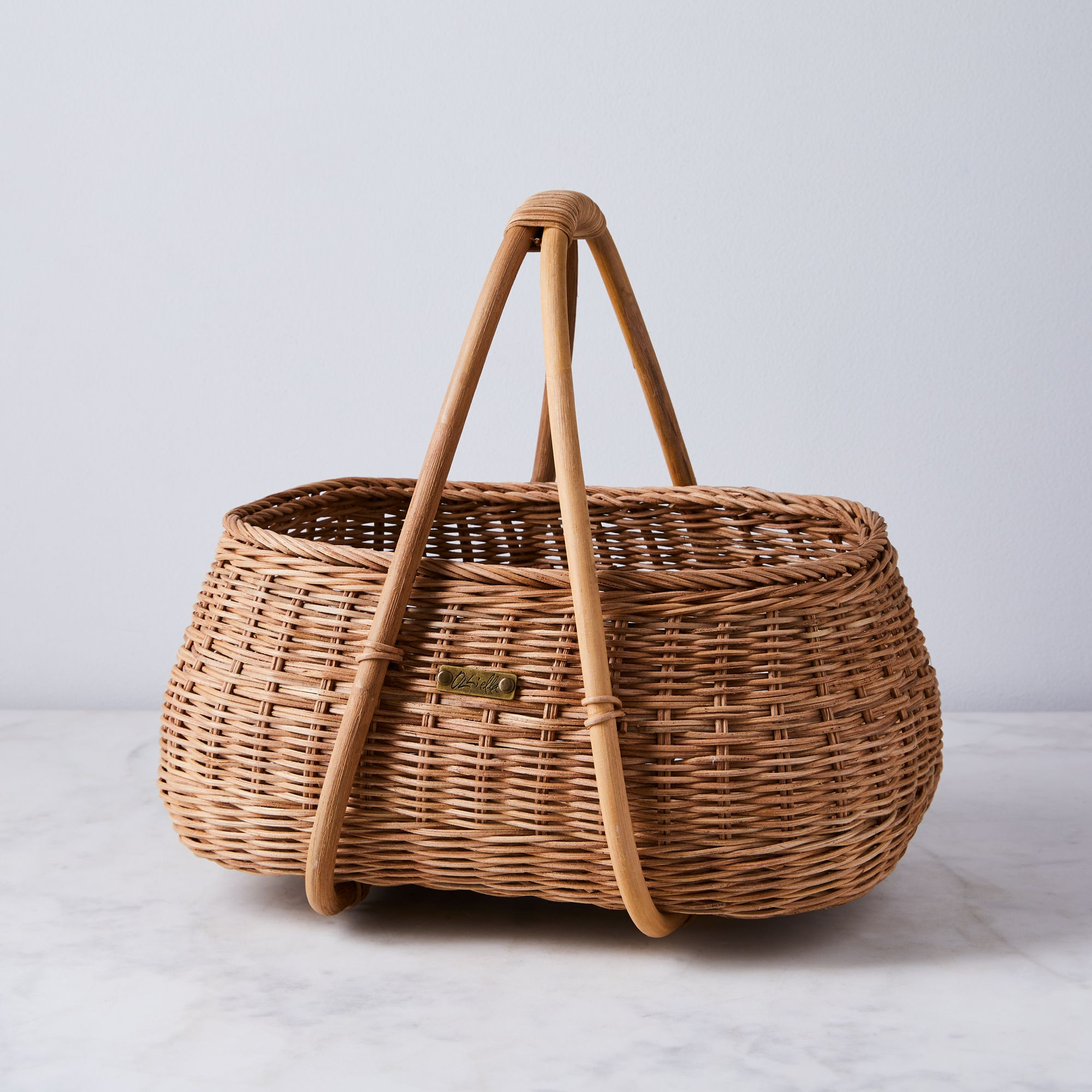 A chic basket by the hearth is perfect for housing cozy blankets and even logs of wood.Olli Ella Mosey Basket, $59, food52.com.