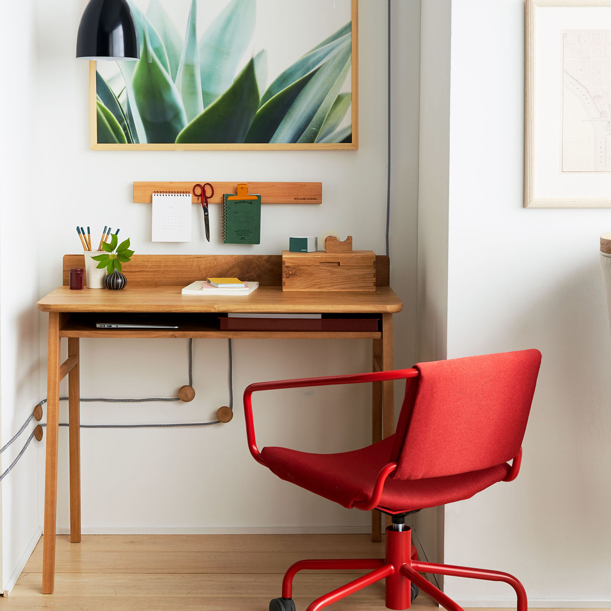 bright red chair and wood desk home office