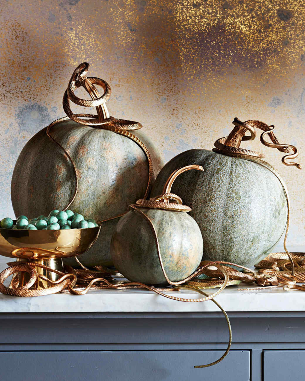 pumpkins adorned with gold snakes