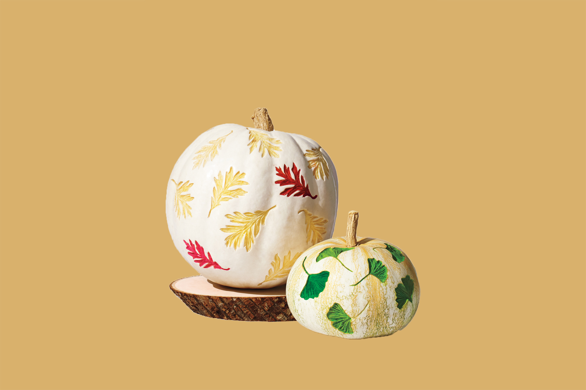 white pumpkins etched with leaves
