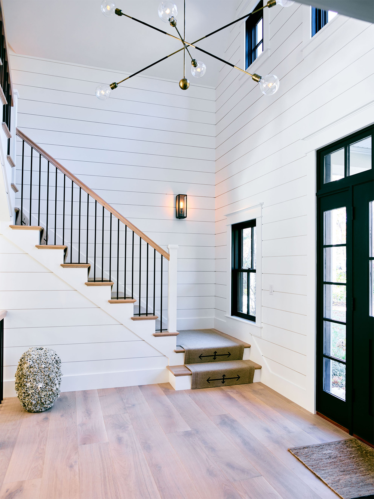 cape cod entry way with white shiplap walls