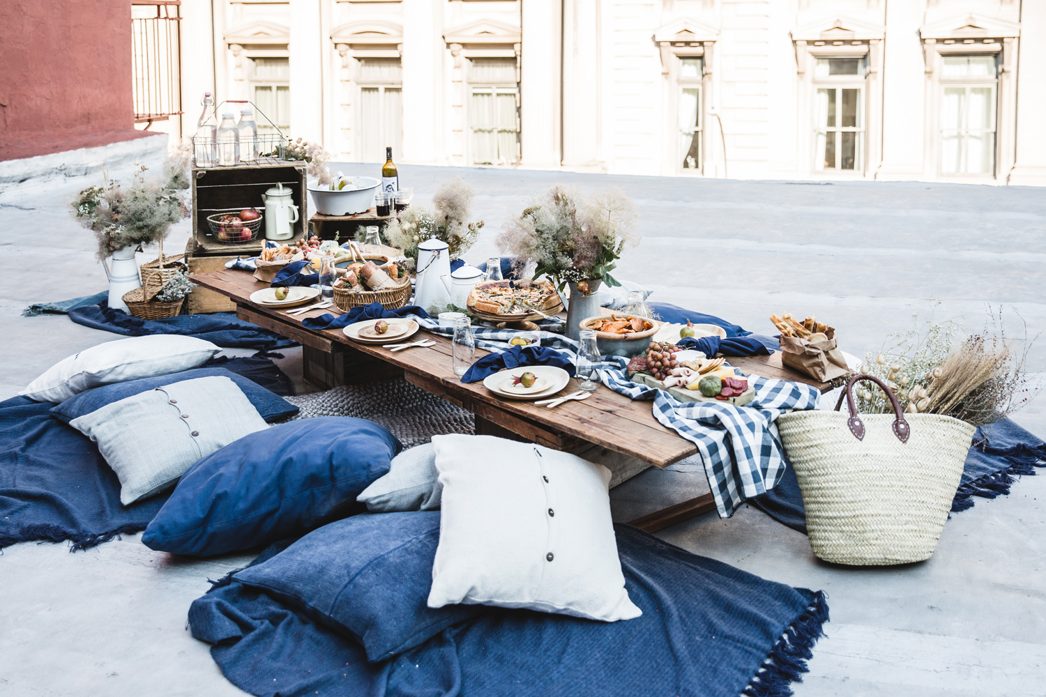 blue pillows and blankets rooftop picnic