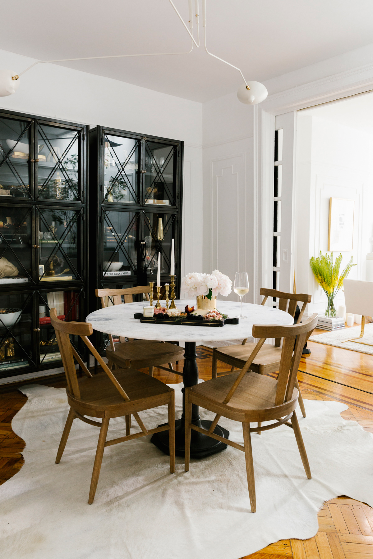 shelby nyc apartment dining room marble table wooden chairs
