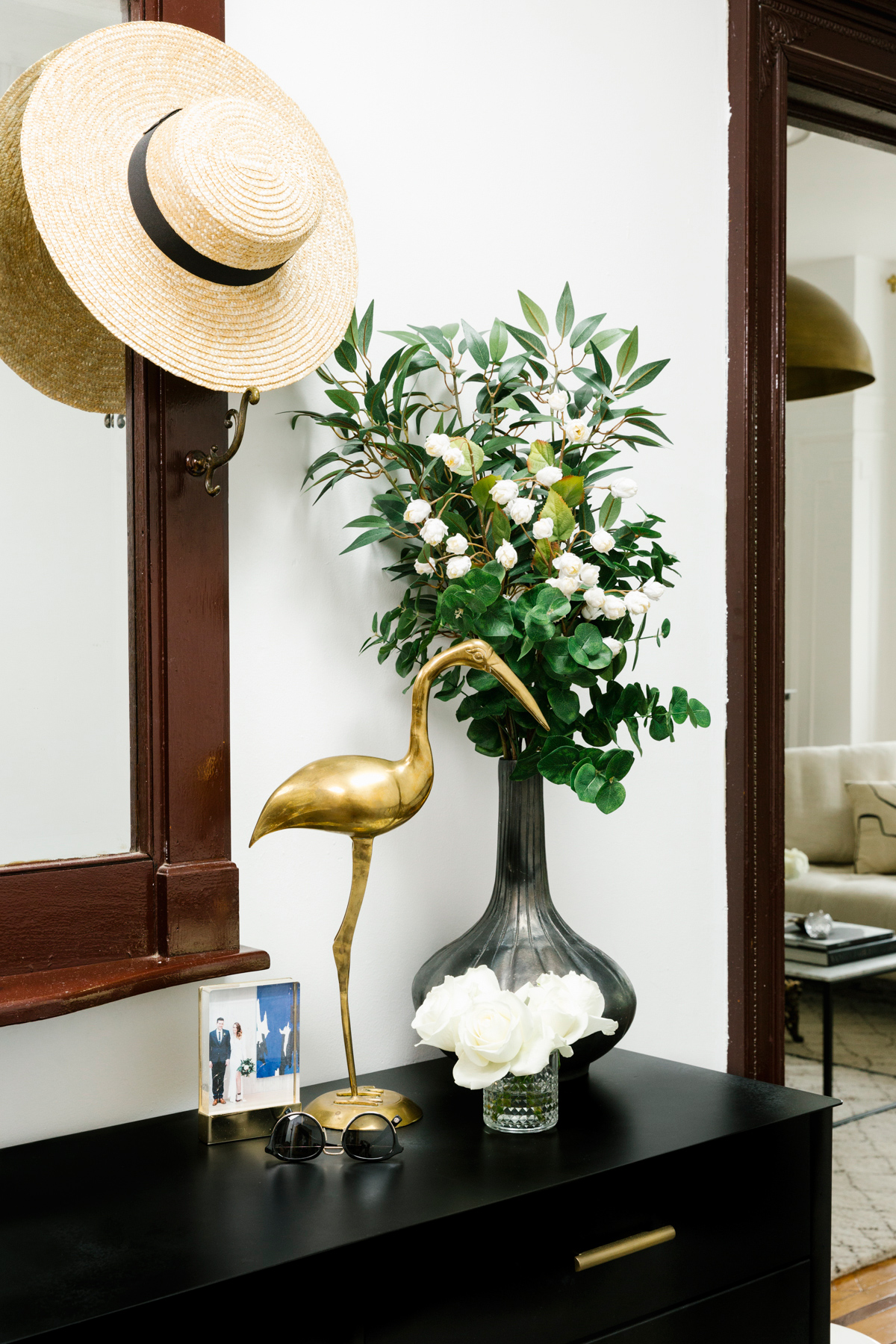 shelby nyc apartment entryway black table with bird statue