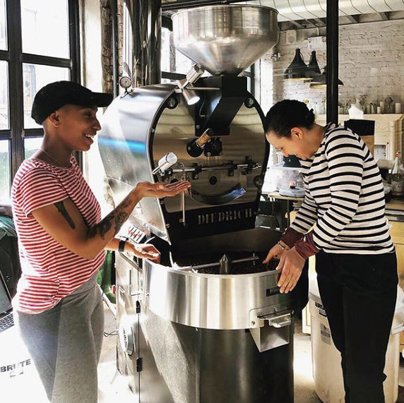 selina and emily grinding coffee