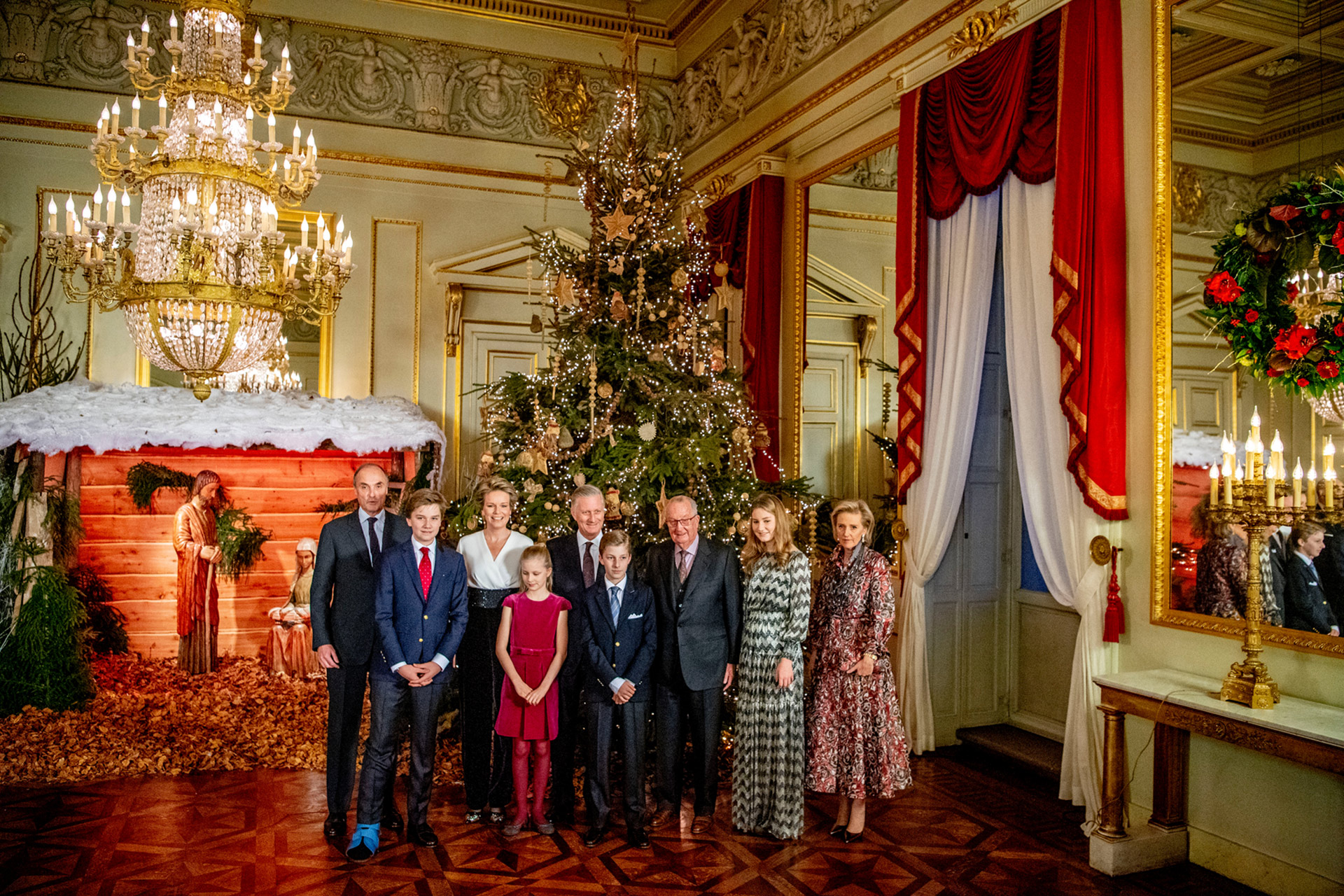 royal family standing together large christmas tree and decor