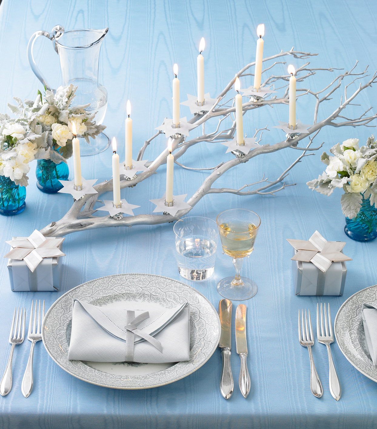 blue and silver themed hanukkah table setting