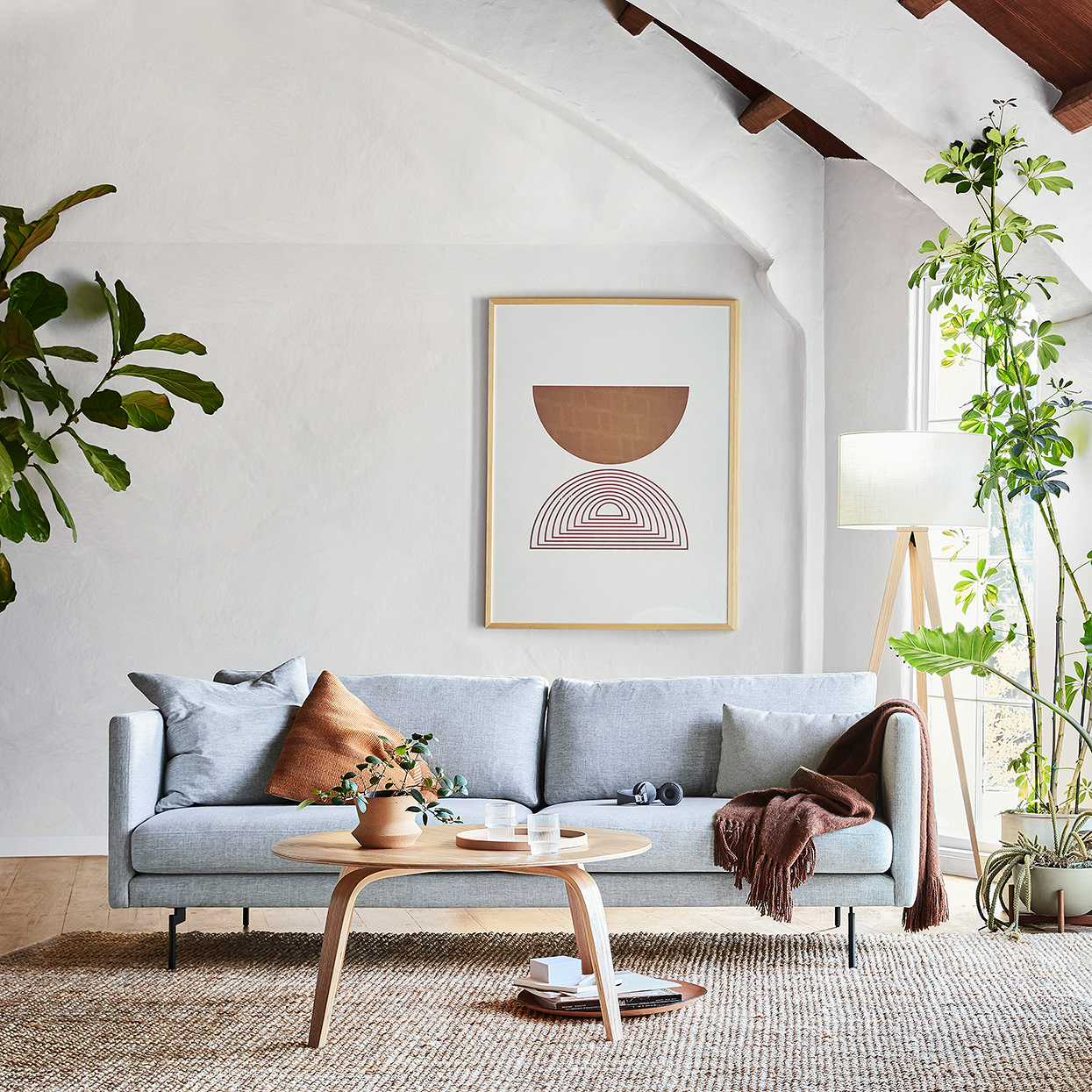 mid-century modern living room with blue Feather sofa