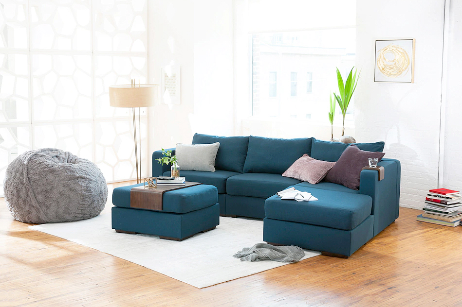 teal Lovesac sectional in minimalist airy room
