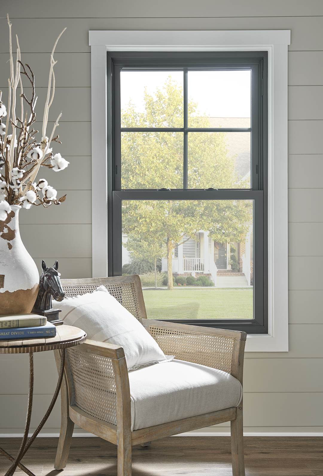 A double hung style window in a house.