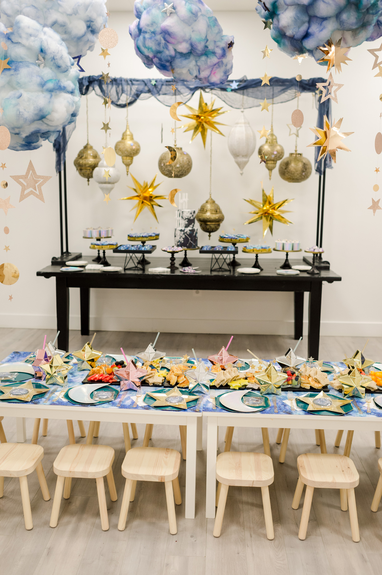 hanging star decor above outer-space table settings